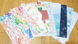 무지개 색, 크리스마스 무늬, 토끼 무늬, 꽃무늬 등 다양한 무늬와 색깔을 가진 A4크기의 종이 여러 장(랩핑지)가 놓여 있다.